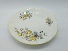 Vintage Rosina Queens fine bone china saucer and tea cup set, yellow floral pattern, made in England.    This cup and saucer set is in excellent condition with no chips or cracks.    Please let me know if there are any questions! | eBay!