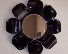 repurpose vinyl records -cut,melted and molded into a flower mirror