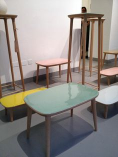 Lu tables by Yuhang Porcelain in porcelain and beech wood.