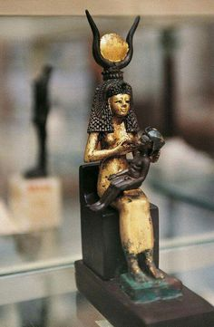 Golden wood statuette of Isis with infant Horus.The treasures of Tutankhamun.New Kingdom, 18th Dynasty.