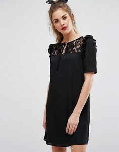 Get this Fashion Union's cotton dress now! Click for more details. Worldwide shipping. Fashion Union Short Sleeve Dress With Lace Panel And Tie Up Bow Neck - Black: Dress by Fashion Union, Lined woven fabric, Round neck, Tied detail, Sheer lace yoke, Ruffle shoulder trims, Regular fit - true to size, Machine wash, 100% Polyester, Our model wears a UK 8/EU 36/US 4 and is 162cm/5'9.5 tall. Fashion Union helps you overhaul your party-girl wardrobe with its standout collection. Head out-out in…