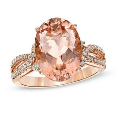 Thought to be the gemstone of the universal heart, the morganite center stone tops a diamond-lined double shank.