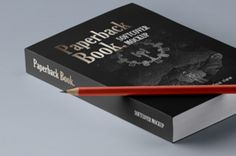 This is an isometric paperback psd book mockup with its pencil. Add your own cover designs with ease thanks to the...