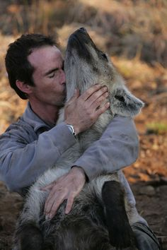 Kevin Richardson, aaaw, he is loving his hyena & it looks like the hyens  is loving him back.