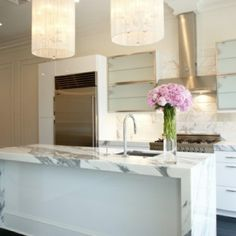 Back Bay marble waterfall countertop - Super Cool! I don't care for the white marble, but in a different granite, this would be awesome.