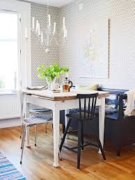 eat in kitchen with a table 4 chairs - love the light and wallpaper the one wall