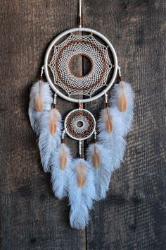 White cream color dream catcher. This is my authors dreamcatcher. Decorated with beautiful ostrich and rooster feathers.The dense woven web inside