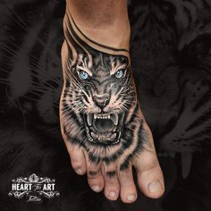 Tiger foot tattoo by Will Jackson in our Heart for Art Tattoo Studio, Manchester.  #tattoo #foottattoo #tigertattoo