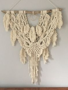 LARGE MODERN MACRAME BOHO WALL HANGING Unfettered Co specializes in handmade modern fibre art and bohemian macrame statement pieces designed to fill your home with warmth, texture, whimsy, and dimension. DESCRIPTION: This beautiful macrame wall hanging with feathers adds bohemian