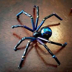 Each Spider is hand made with glass beads and soft wire that is easily bent to any desired form. Leg span is approximately 2-3 inches wide. Custom Colors/combinations available upon request