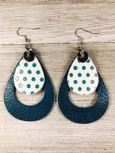 This is a 3 inch pair of teal/bluish green earrings in a teardrop cut. It has a smaller white and teal polka dot teardrop on top and the rest of the earrings is cut out. It is lightweight with stainless steel ear wires. It comes with rubber stoppers Diy Leather Earrings, Bow Earrings, Leather Jewelry, Statement Earrings, Earrings Handmade, Handmade Jewelry, Green Earrings, Designer Earrings, Fine Jewelry
