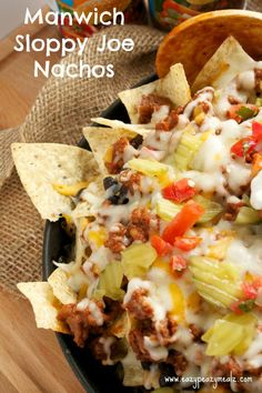 Manwich Sloppy Joe Nachos: Kick your nachos up with sloppy joe seasoned meats, pico, pickles, and more! Perfect appetizer or meal! - Eazy Peazy Mealz #ad