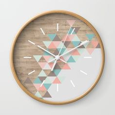 "Available in natural wood, black or white frames, our 10"" diameter unique Wall Clocks feature a high-impact plexiglass crystal face and a backside hook for easy hanging. Choose black or white hands to match your wall clock frame and art design choice. Clock sits 1.75"" deep and requires 1 AA battery (not included).                                                                                                                                                                                 More"