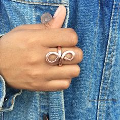 Figure 8 copper ring. Crafted from 12 gauge solid copper wire. Hammered and filed to a smooth shiny finish. Ring shown is UK US 7 1/4. This ring is