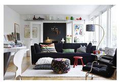 dark accent wall + high shelf + dark couch