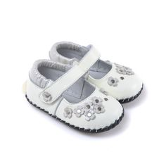 """Caroch   Cassie   Soft sole baby shoes """"Cassie"""" is crafted from soft white leather with silvery pearl flowers and heel, and silver stud details across the toes."""