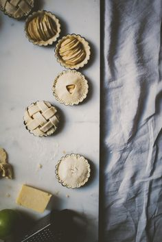"bettysliu: "" White cheddar apple pies with cinnamon infused honey. """
