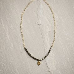 """Ronda Smith Designs """"Danielle 84"""" Short Necklace- Handmade with pyrite beads, 14K gold fill chain, and 14K gold fill leaf pendant."""