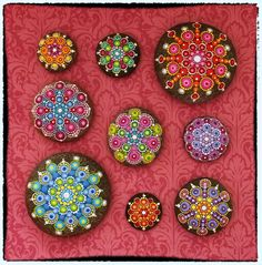 Elspeth McLean mandala stones #elspethmclean #mandala #stone #decoratedrocks #rockart #rainbow