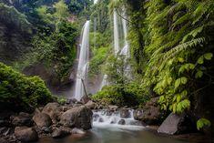 Gaëlle est la spécialiste de Bali et de ses secrets chez Bali Autrement. Avec elle, essayons de savoir s'il existe encore des lieux préservés du tourisme de masse sur cette île paradisiaque... Entre fantasmes et réalité, Bali et sa culture n'a pas fini de fasciner... Voyage Bali, Waterfall, Culture, Outdoor, Pathways, Tourism, Places, Outdoors, Waterfalls