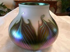 This is a signed Charles Lotton Art Glass Pulled Feather Iridescent Vase. Wow!