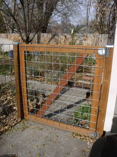 DIY 2x4 wire filled gate. Not pretty but would keep the dogs in!