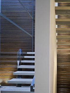:: STAIRS :: Beautiful juxtaposition of heavy stair treads with a fine scaled wood screen behind
