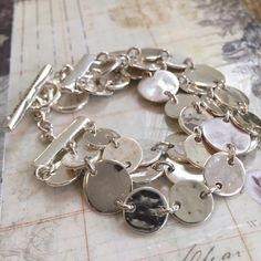 "C+I | Pressed Paillette Toggle Bracelet •Part of my C+I sample sale•  Modern sculpted paillettes in shiny + worn silver deliver a style staple worthy of repeat appearances. - shiny + worn silver-plated - nickel-free plating - 6.75"" - 7.75"" approx. length - toggle closure Chloe + Isabel Jewelry Bracelets"