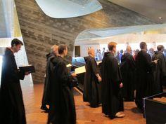 The Monks of St. John's File in for Prayer