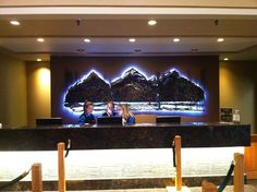 Our newest project at Banff Park Lodge. Using new flexible LED technology, we installed the lighting under the front counter and RGB lighting behind their beautiful metal sculpture at the front desk. The RGB LED lighting can be controlled by a remote control. The advantage of LED lighting is the small amount of space it requires and the low amount of power it takes to run them. Let us know if we can help brighten your day.