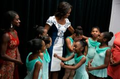 The First Lady in an incredibly elegant blue and white Carolina Herrera dress as she greets the all-too-cute dancers from the Dance Theatre of Harlem.