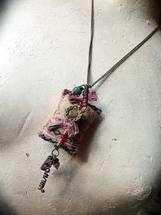Gypsy bohemian vintage Hmong textile necklace with bead, copper charms and mystic coated quartz