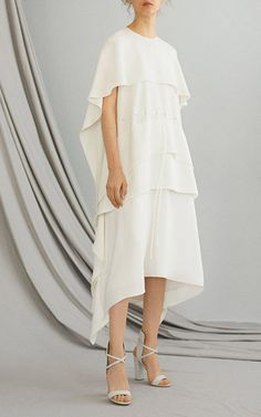 This **Adeam** dress features a capeline top with eyelets and drawstring for definition.
