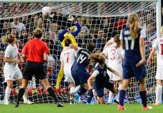 Image: Canada's goalkeeper Erin McLeod (center, in yellow) can't quite reach a goal made by Alex Morgan of the US to win the women's semifinal soccer match on Monday (© Nigel Roddis/Reuters)