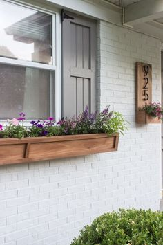 These DIY window boxes are the perfect finishing touch for your home's exterior. Find a tutorial here that works for your home, and watch how easily these window box project's elevate your home's exterior. Window Planter Boxes, Outdoor Decor, Planters For Shade, Cedar Window Boxes, Front Yard, Wooden Flowers, Diy Curb Appeal, Diy Window, Fall Window Boxes