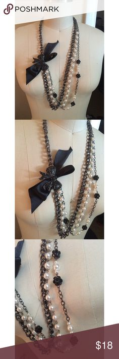 Girly 3-Chain Bow & Pearl Necklace Brand new, never been worn. Was a gift from my friend. It's a beautiful necklace and could go with an all black outfit. All chains are connected to one clasp. I'm looking for someone who might love these more than me.  Check my page for other cute stuff! I mostly sell clothing/accessories/jewelry/makeup!  Jewelry Necklaces