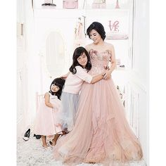 one fine fun day with @joe_taslim 's family  Julie in our Rosegold Long Tulle Gown - Provocate by #meltatan    #photo by: @babyaxioo   @iconsalim @avelinegunawan    #makeup by: @momogi    #style by: @vivalavanie @jepherjepho    #muse : @julietaslim and her cute daughters   #venue : La La Land #axioo    #provocatebymeltatan #design #dress #gown #long #tulle #rosegold #jacquard #bustier #photo #fairytale #fashion #fun  #family