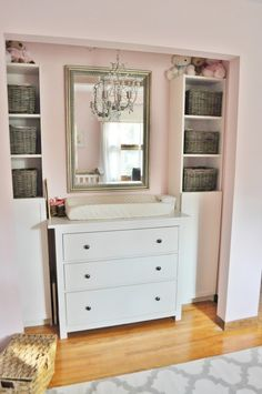 Pull the doors off the closet, add built-ins/shelves and place changing table inside. Great use of space!
