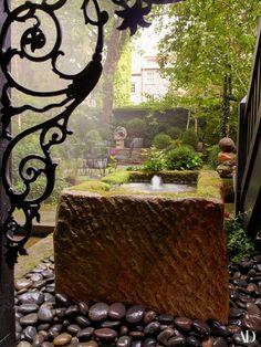 West Village townhouse of Julianne Moore, Architectural Digest (November 2017). An antique english trough in the sawyer | Berson–designed garden. Woodard outdoor furniture; sculpture by Alma Allen.