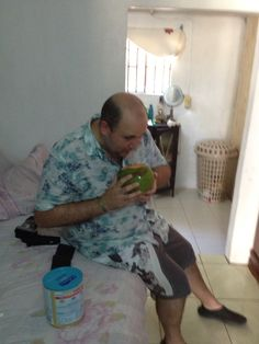 Drinking coconut jelly at my girlfriend's house in Jamaica.