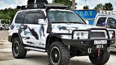 About car: 2004. 2004 Toyota Land Cruiser 4.7 Automatic basic spec sheet: — Front bumper — Rear Bumper — Trunk — A staircase to the roof — Thresholds — Snorkel — Protection of the crankcase, handout, automatic transmission — WARN Winches — A / V winches (radio remotes) — LED optics for special equipment ProLight…