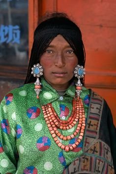 Asia | Portrait of a Tibetan woman wearing traditional jewelry, Tibet | © Steve McCurry #beads #silver