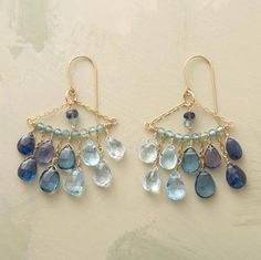 Thoi Vo arranges aquamarine, blue topaz, iolite, kyanite and apatite rendezvous in stunning chandeliers that make the most of the blue spectrum. 14kt goldfilled links and French wires.