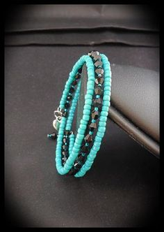 Items similar to Black Glass Bicone Crystals and Turquoise Seed Bead Memory Wire Bracelet. on Etsy Items similar to Black Glass Bicone Crystals and Turquoise Seed Bead Memory Wire Bracelet. Bracelet Fil, Bracelet Making, Jewelry Making, Memory Wire Jewelry, Memory Wire Bracelets, Diy Schmuck, Schmuck Design, Beaded Jewelry, Handmade Jewelry
