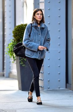 Simply stylish: Alexa nails cosy and cool in faux fur  and signature flats, as she is spotted in New York City this Monday. Fans the IT girl, author and modelcan shop a similar look in her latest 'Archive' collection for Marks & Spencer.