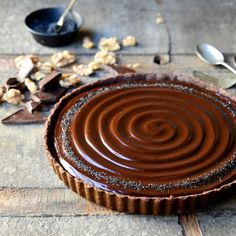 The most decadent no-bake chocolate tart with layers of toasted walnuts & caramel, chocolate ganache and sea salt. No oven needed!