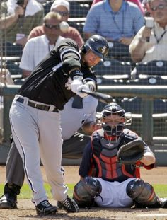 Chicago White Sox catcher A.J. Pierzynski launches a solo home run in a spring training game.