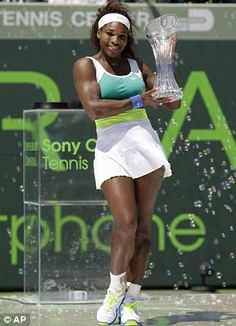 Serena Williams posing with her Sony Open Trophy.