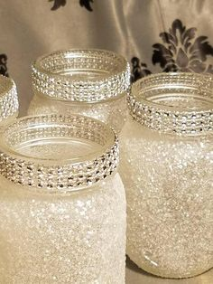 mason jar crafts Pint-size mason jars glittered with fine iridescent white glitter with diamond wrap around the mouth of the jar. These are small 16 oz jars that are sealed to prevent Pot Mason Diy, Mason Jar Crafts, Pots Mason, Crafts With Jars, Small Centerpieces, Wedding Centerpieces, Christmas Centerpieces, Quinceanera Centerpieces, Wedding Decorations