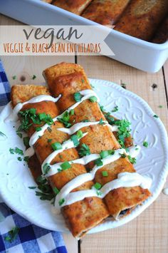 Vegan Veggie and Black Bean Enchiladas - Delicious, healthy and easy to make. What could be better? These make the perfect weeknight meal!